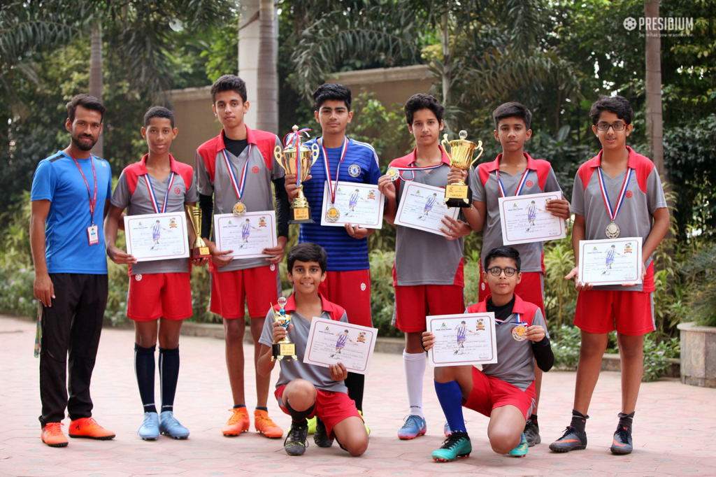 YOUNG FOOTBALLERS HIT THE VICTORY GOAL AT THE FOOTBALL TOURNAMENT